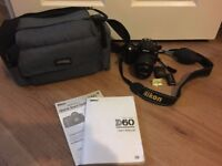 Nikon D60 with 18-55mm lens, bag, battery and charger