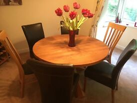 We sadly are selling our lovely dining table it is in pristine condition and is solid oak