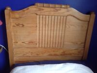 """Antique pine bed with detailed head and footboard, slatted base and bespoke mattress (5'9"""" x 2'3"""")"""