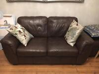 Pair of two seat leather sofas with footstool - brown