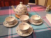 China tea cups with teapot
