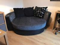 DFS Black & grey cuddle chair with audio centre