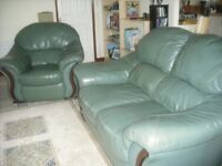 Two piece leather suite, sofa and arm chair in green leather