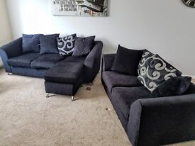 Black two seater and 3 seater sofa.