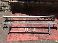 Transit roof rack with roll bar