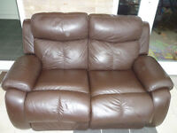 2 seater recliner brown leather sofa. Free delivery.