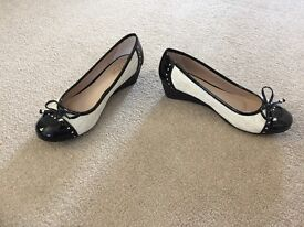 Cream and black Lotus wedge shoes