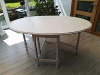 Oval dining table, drop leaf, painted in palest of grey, slightly shabby chic.