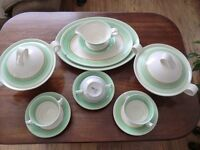 Clavice Cliff Newport Pottery/Part Dinner Service Green & Gold Decoration.