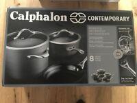 Brand new Calphalon 8 piece non-stick pots and pans