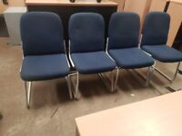4 blue matching office chairs