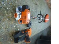 Stihl petrol strimmer near mint only 2 years old (sells now for £370 without harness see photo 2)