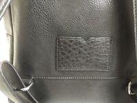 Black faux leather rucksack