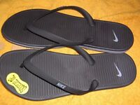 pair of nike flip-flops new and boxed