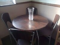 Dark Wooden and metal dining table and chairs
