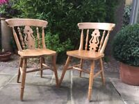 Two wooden country style chairs