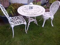 medium size aluminium garden or patio table with two chairs and lantern can deliver