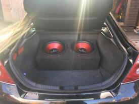 Twin sub with monoblock amp and power cap