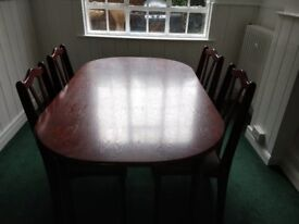 Dark Wooden Round Table With 4x Matching Cushioned Chairs
