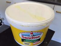 Approx 5 Litres of Sandtex Smooth Cornish Cream Masonry Paint being half of a 10l tub