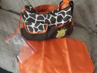 Baby Nappy Changing Bag. Giraffe/brown/orange, lots pockets, hardly used.