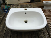 White semi recessed inset sink,