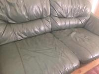 Green leather 2 seater sofa.