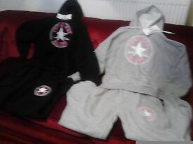 Two girls converse hooded suits