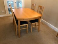 Extendable Dining Room Table and Four Chairs For Sale