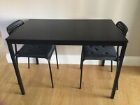 Ikea black table and two chairs