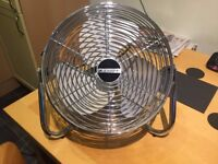 A stylish chrome Bionaire High Velocity Air Circulator with 3 speed settings.