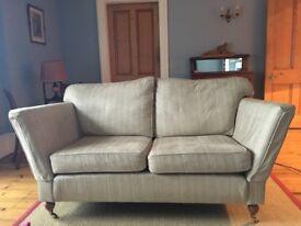 Matching pair beige fabric 2 seater sofas