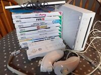 Wii with games and controllers