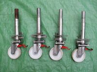 FOUR ADJUSTABLE SCAFFOLD TOWER LEGS AND WHEELS MADE BY ZARGES OF GERMANY
