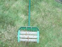 Garden tool for spiking lawns.