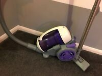 Purple and white vacuum cleaner