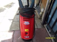 a clarke big pressure washer with a metal lance