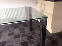 Next glass and Crome dining table