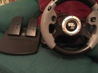 PlayStation 3 steering wheel and pedals