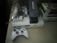Xbox 360 2 controllers 1 wireless 1 wired and a selection of games
