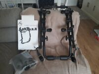 NEW - NEVER USED Rear bike car rack that can fit to any car (holds 3 bikes)