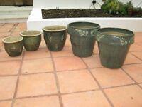 Five green garden pots, including one trio