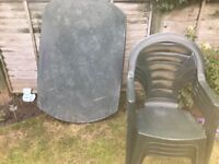 Green plastic garden table and four chairs table top needs TLC chairs in good condition