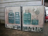 A PAIR OF LARGE CALOR GAS ADVERTISING SIGNS GALVANISED FRAMES