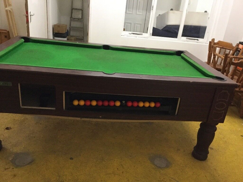 6ft pool table with money slot.