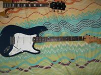 Royal blue Squier Stratocaster gold logo Korean made 1997 with gig bag