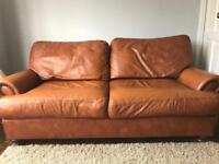 Tan leather sofa and two armchairs