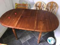Pine extending dining table and four matching chairs