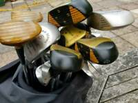 Set of ladies golf clubs as well as additional clubs