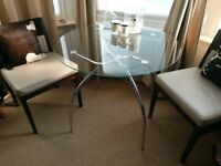 Tempered glass round dining table with chrome legs